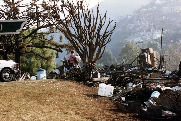 Two Laguna residents stand by debris pile