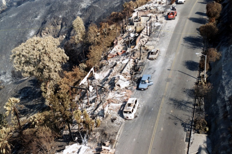 Aerial view of burned down houses and cars